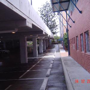 Between New Carpark and Existing Building
